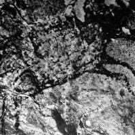 Изображение кабана. Пещера Паттэ. Наскальная живопись. Охра, красный пигмент. Дл. 50 см. Неолит. Южный Сулавеси